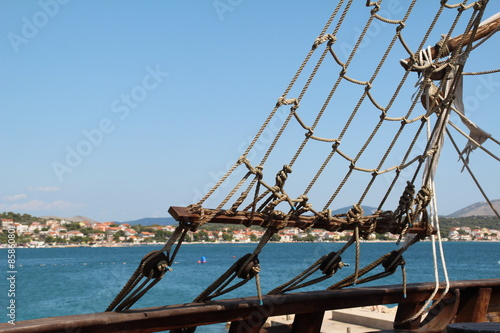 Keuken foto achterwand Schip Sails / Sails of a pirate ship on a background of blue sky.
