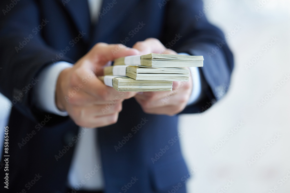 Fototapety, obrazy: closeup money in male hands