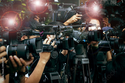 Fototapeta press and media camera ,video photographer on duty in public new obraz