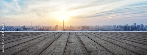 Tuinposter Panoramafoto s Panoramic skyline and buildings with empty wooden board