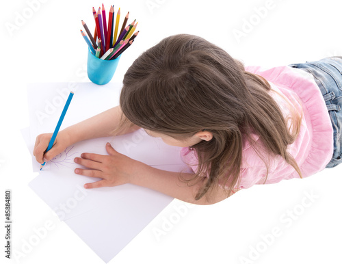 back view of little girl drawing with colorful pencils isolated