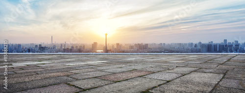 Tuinposter Panoramafoto s Panoramic skyline and buildings with empty brick square