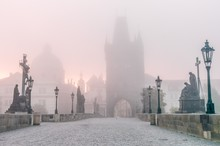 Charles Bridge In Prague At Foggy Morning