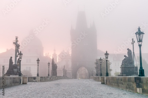 Charles Bridge in Prague at foggy morning Canvas Print