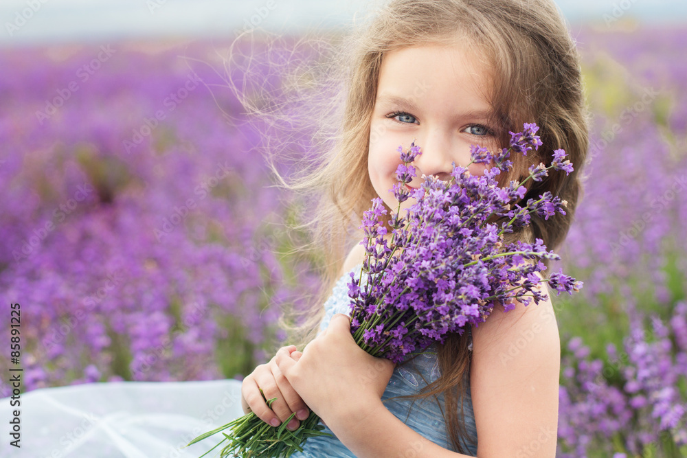 Fototapety, obrazy: Happy little girl in lavender field with bouquet