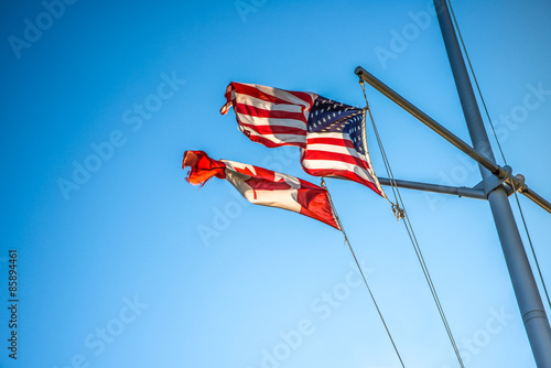 Canadian & American Flags - Buy this stock photo and explore