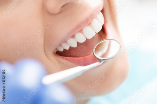 Fotografering  Close-up of woman having her teeth examined
