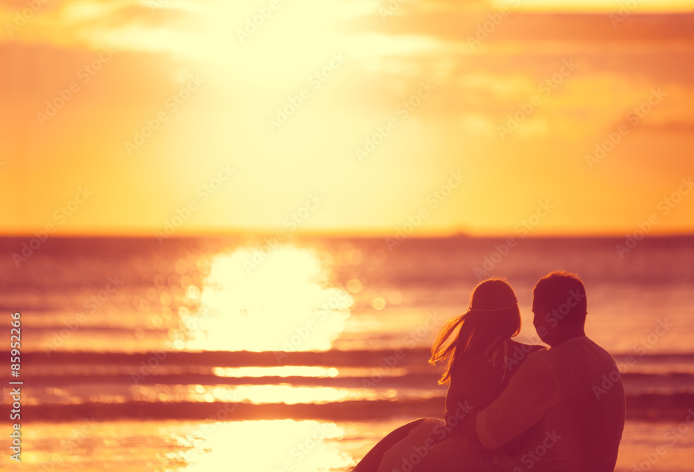 Fototapeta Romantic couple looking sunset