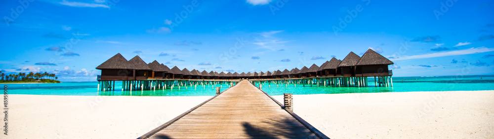 Fototapeta Water bungalows and wooden jetty on Maldives
