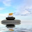 Zen spa concept background - Zen massage stones reflected in water