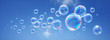 Leinwandbild Motiv Seifenblasen vor blauem Himmel 2