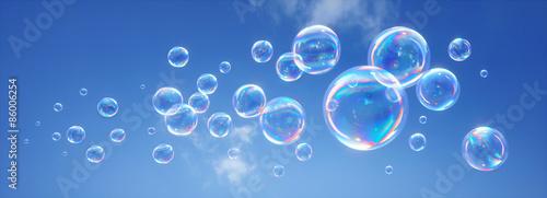 Fotografering  Seifenblasen vor blauem Himmel 2