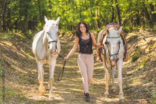 Fotografia, Obraz  Outdoor photo from a beautiful young women with her horse