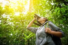 Tourist Looking Through Binoculars Considers Wild Birds