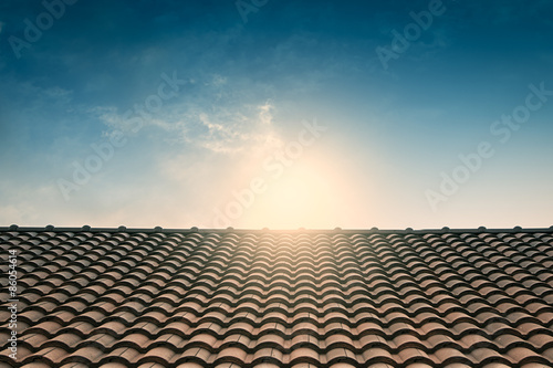 Fototapeta red tile roof blue sky,vintage filter obraz