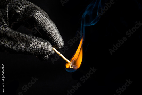 Close-up of hand with match flame Canvas Print