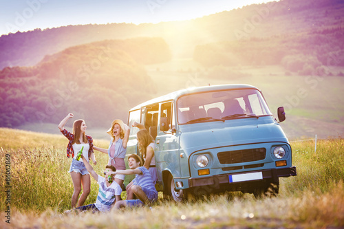 Fotografie, Tablou  Young hipster friends on road trip