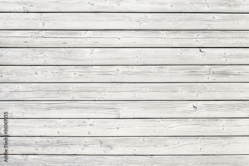 Old wooden board with nails in white
