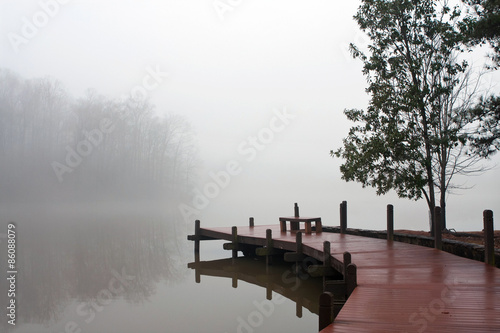 Photo sur Toile Bestsellers Thick Blanket Of Fog Covers Lake And Wooden Dock