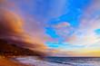 Poglina beach under a colorful sky at sunset