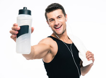 Smiling Fitness Man Holding Towel And Bottle With Water