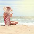 Happy girl at sea beach