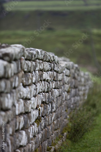 Foto op Plexiglas Wand A dry stone wall, a traditional stone wall in the Northumberland landscape.