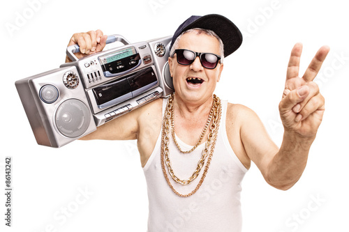 Photo  Toothless senior rapper holding a boombox