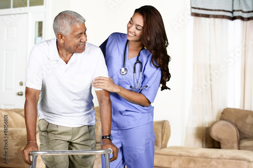 Fotografia  Health Care Worker and Elderly Man