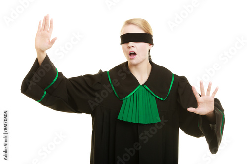 Fotografie, Obraz  Blind justice. Woman covering eyes with blindfold