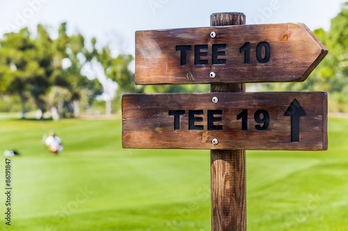 Fototapeta  Wooden sign posts at golf course.