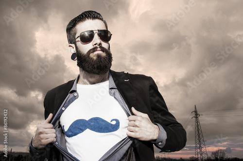 Fotografie, Obraz  young hipster superhero under a dark sky