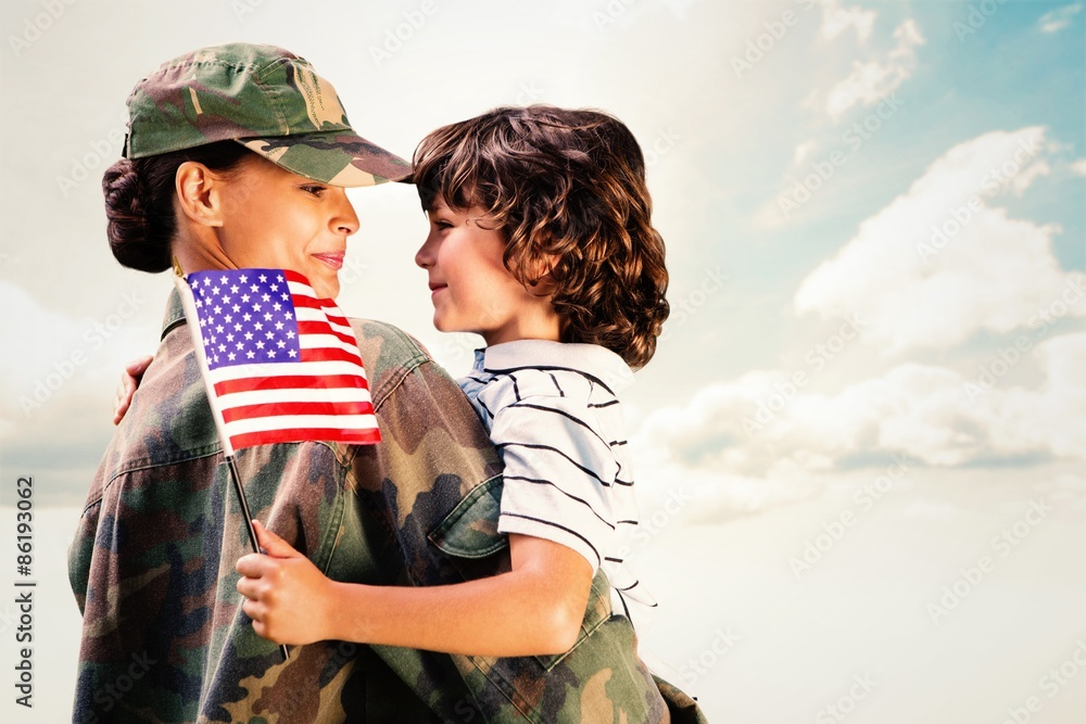 Fototapeta Composite image of solider reunited with son