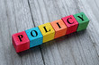 canvas print picture - word policy on colorful wooden cubes