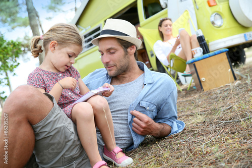 Staande foto Kamperen Daddy with little girl playing together on campground
