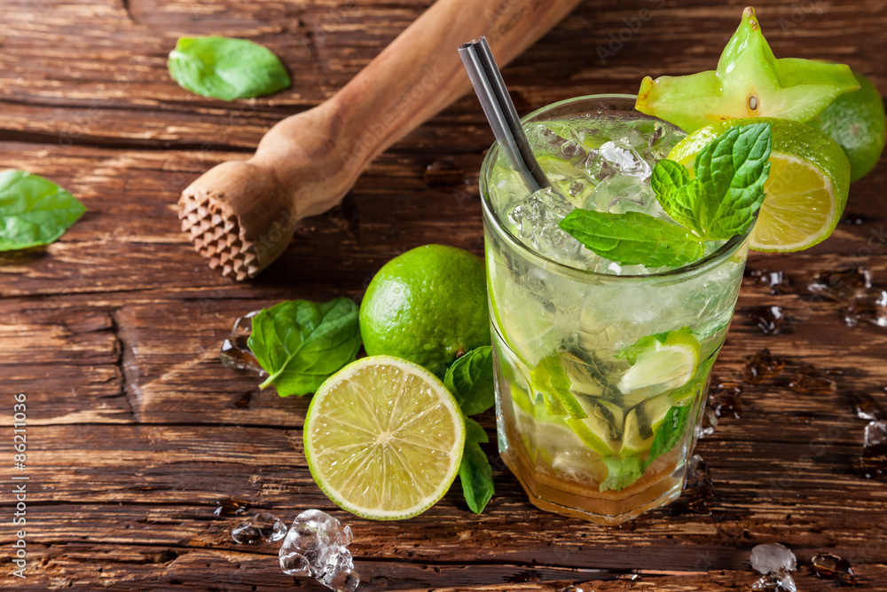 Fototapeta Mojito drink on wooden planks