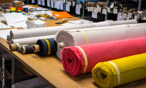 Fotobehang Stof Fabric rolls, many colors assortment