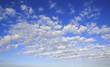 canvas print picture - Beautiful cumulus cirrus clouds in blue sky.