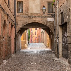 Obraz na Szkle Uliczki Ancient medieval street in the downtown of Ferrara city