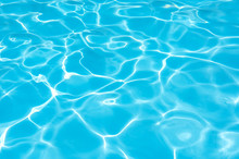 Blue Water Surface In Swimming Pool