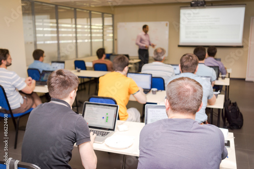 rear view of the students in computer class Canvas Print