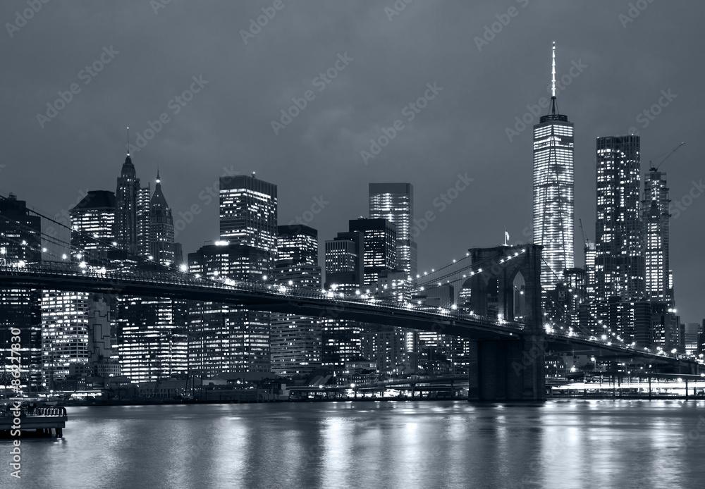 panorama new york city at night, brooklyn bridge and blue tonali