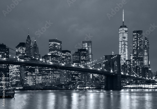 panorama new york city at night, brooklyn bridge and blue tonali