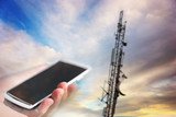 mobile phone aiming at telecommunication tower - 86241489