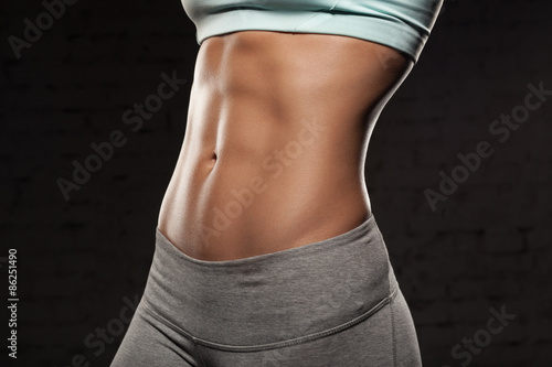 Cuadros en Lienzo Fitness female woman with muscular body, do her workout, abs, abdominals