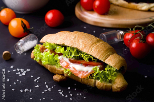 Staande foto Snack Croissant sandwich with salted salmon