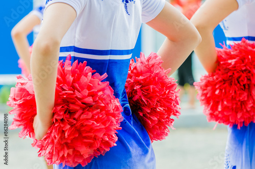 Cuadros en Lienzo young female cheerleaders holding pom-poms during competitions