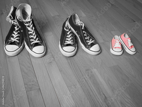 An Image Of Two Pairs S Sneakers In Black And White Next To A Baby