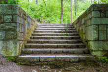 Old Stairs In Park Covered With Moss From Dampness.