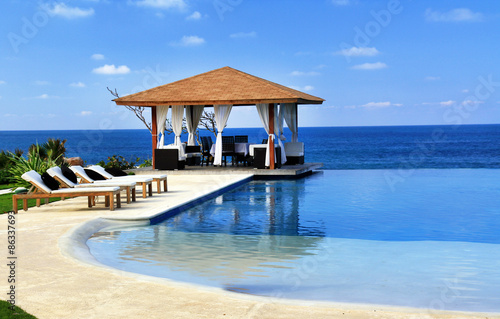 Pavilion and swimming pool in resort Canvas Print